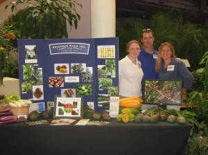 Kim Erickson, Rich Johnston and Krista Erickson show off their tropical specialties